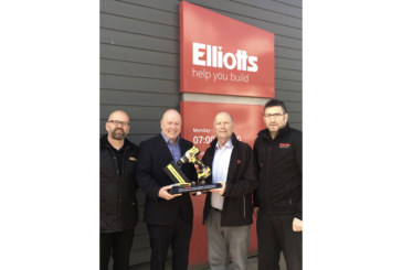 Elliotts receives commemorative trophy