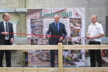 Covers launches renewed timber mill