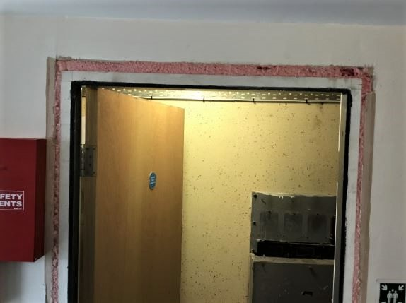 Pink foam in door frame. Credit Trident Building Consultancy